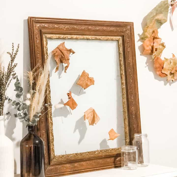 Image os seasonal decor including dried grasses, leafs and florals