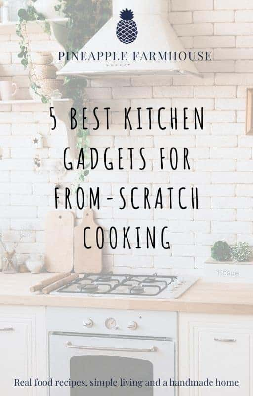 Cover page of free ebook titled 5 Best Kitchen Gadgets For Quick And Easy From-Scratch Cooking with picture of kitchen in the background with white subway tiles, a gas cooktop and under bench oven, white range hood, open shelving with kitchen wares, wooden chopping boards, and plants. There is the Pineapple Farmhouse name and logo on the top and the tagline Real Food Recipes, simple living and a handmade home at the bottom.