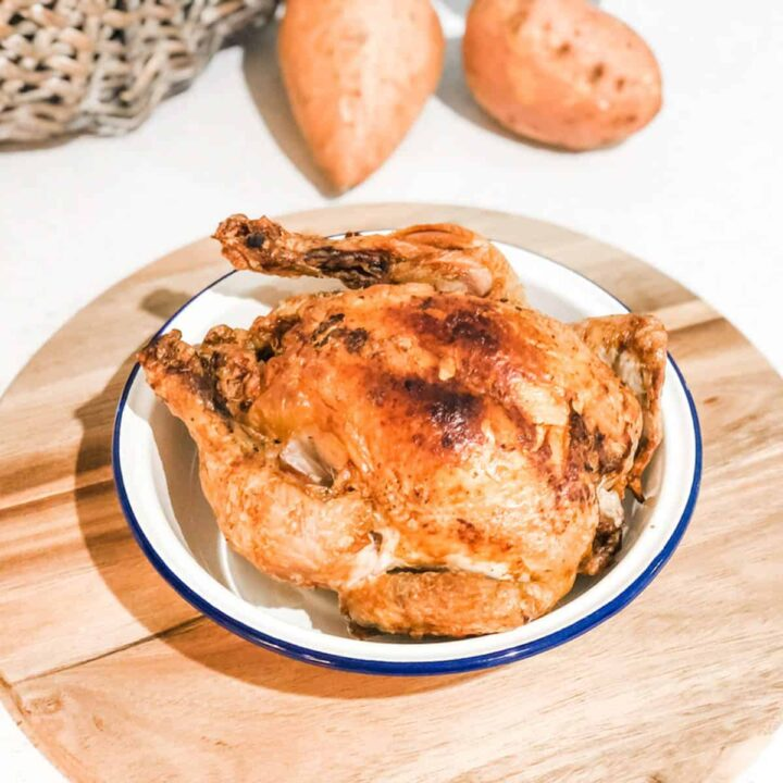 image of a whole roasted chicken in an enamel bowl